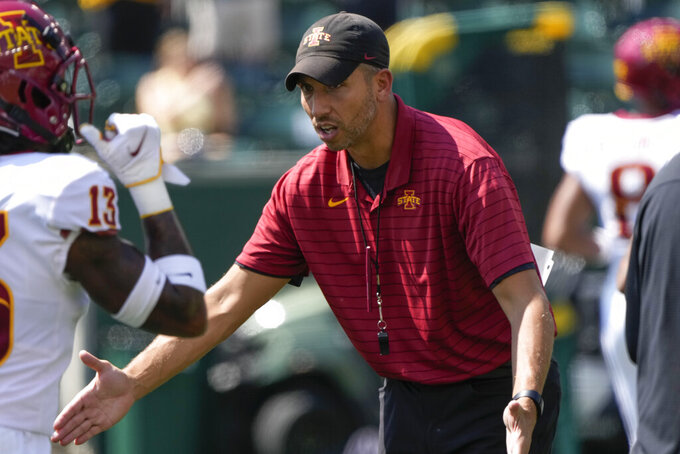 Iowa State head coach Matt Campbell greets players as they enter the field during team warmups before an NCAA college football game against Baylor, Saturday, Sept. 25, 2021, in Waco, Texas. (AP Photo/Jim Cowsert)