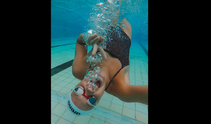 This is a Feb. 5, 2019 photo provided by Olympic swimmer Erin Gallagher of her swimming under water in Durban, South Africa. Gallagher got COVID-19 late last year and went from elite Olympic athlete in peak condition to lying flat on a bed concentrating on just breathing. And yet she's one of the lucky ones. She recovered and is going to Tokyo. Other African hopefuls have not been so fortunate as the coronavirus surges again across the continent just as the Olympics approach. (Erin Gallagher via AP)