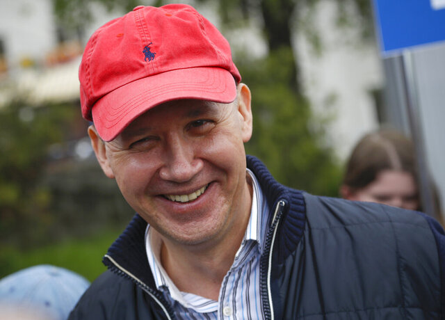 In this picture taken on Wednesday, May 26, 2020, Valery Tsepkalo, a potential candidate in the upcoming presidential election, smiles in Minsk, Belarus. The central elections commission in Belarus has rejected a top challenger's bid to run against authoritarian President Alexander Lukashenko in this summer's election. Tsepkalo, a former ambassador to the United States and a founder of a successful high-technology park, submitted 160,000 signatures on petitions to get on the ballot for the Aug. 9 election, but the commission said only 75,000 were valid less than the 100,000 needed.(AP Photo/Sergei Grits)