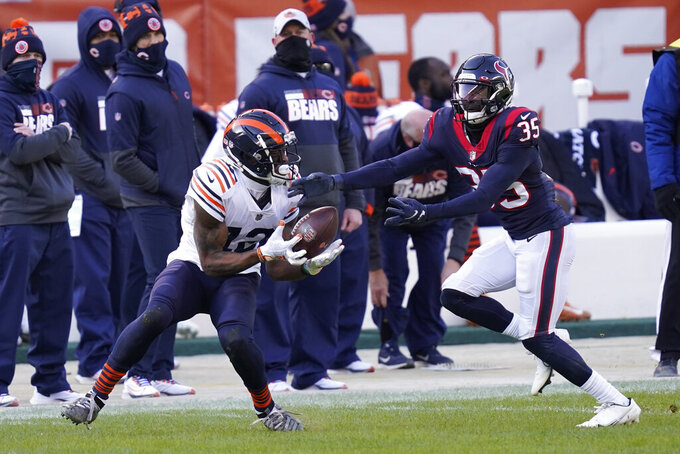 Chicago Bears' Allen Robinson (12) makes a catch against Houston Texans' Keion Crossen (35) during the first half of an NFL football game, Sunday, Dec. 13, 2020, in Chicago. (AP Photo/Charles Rex Arbogast)