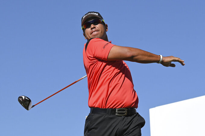 Hideki Matsuyama, of Japan, watches his tee shot on the 18th hole during first round of the CJ Cup golf tournament Thursday, Oct. 14, 2021, in Las Vegas. (AP Photo/David Becker)