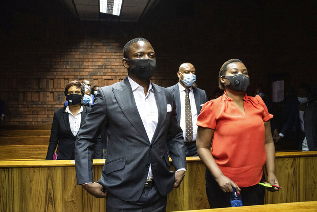 Self proclaimed prophet Shepherd Bushiri and his wife Mary, right, in the magistrates court in Pretoria, South Africa, Friday, Oct. 30, 2020 during a bail application. Bushiriri has triggered anger, a diplomatic incideBushiriri has triggered anger, a diplomatic incident and a good amount of head scratching by authorities in South Africa after he escaped from the country while facing criminal charges. Bushiri and his wife failed to report to a police station on Friday, Nov. 13 to meet their bail conditions and then appeared in their home nation of Malawi over the weekend.nt and a good amount of head scratching by authorities in South Africa after he escaped from the country while facing criminal charges. (AP Photo)