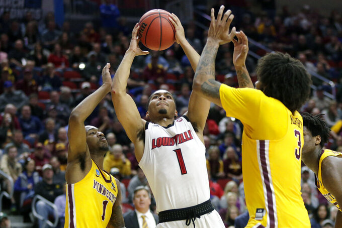 Louisville's Christen Cunningham (1) goes to the basket against Minnesota's Dupree McBrayer, left, and Jordan Murphy (3) during the first half of a first round men's college basketball game in the NCAA Tournament, in Des Moines, Iowa, Thursday, March 21, 2019. (AP Photo/Nati Harnik)