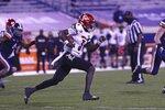 Louisville quarterback Malik Cunningham (3) runs the ball during an NCAA college football game  against Virginia Saturday, Nov. 14, 2020, in Charlottesville, Va. (Erin Edgerton/The Daily Progress via AP)