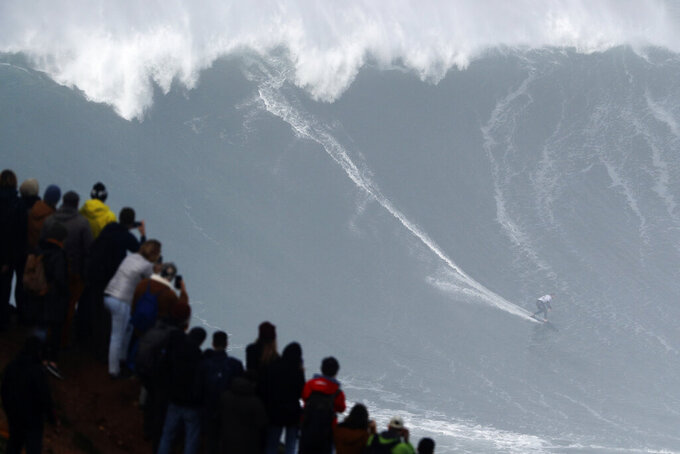 Sebastian Steudtner from Germany rides a wave during the Nazare Tow Surfing Challenge at Praia do Norte or North Beach in Nazare, Portugal, Tuesday, Feb. 11, 2020. (AP Photo/Armando Franca)