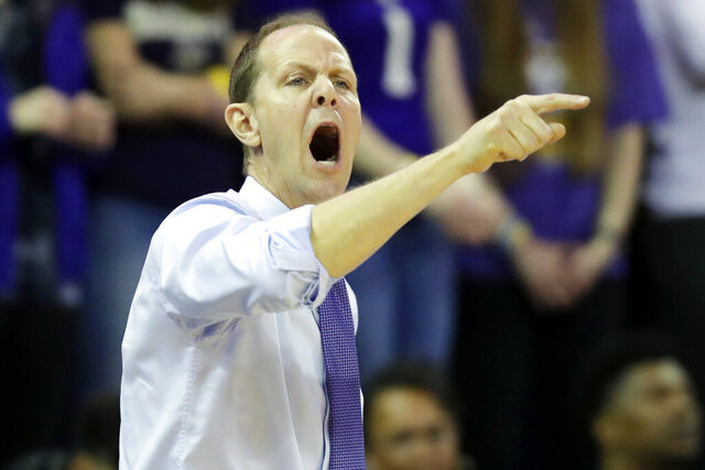 Washington head coach Mike Hopkins calls to his team during the first half of an NCAA college basketball game against the Oregon State, Thursday, Jan. 16, 2020, in Seattle. (AP Photo/Ted S. Warren)