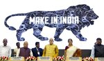 "FILE - In this Thursday, Sept. 25, 2014. file photo, Indian Prime Minister Narendra Modi, center, unveils the logo of 'Make in India' initiative in New Delhi, India. Modi and the BJP on Thursday, May 23, 2019, claimed a thunderous sweep of India's general elections, winning well over the 272 seats in the lower house of Parliament required to form a government. Modi described his first term in office as ""filling in potholes,"