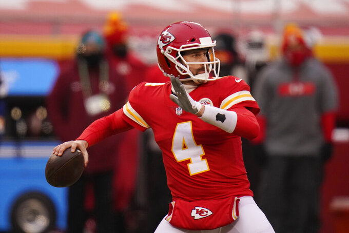 Kansas City Chiefs quarterback Chad Henne throws a pass during the first half of an NFL football game against the Los Angeles Chargers, Sunday, Jan. 3, 2021, in Kansas City. (AP Photo/Jeff Roberson)