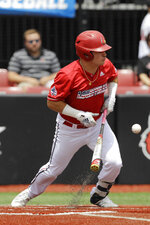 Louisville's Danny Oriente bunts for a hit against East Carolina during the second inning in Game 2 of the NCAA college baseball super regional tournament, Saturday, June 8, 2019, in Louisville, Ky. (AP Photo/Darron Cummings)