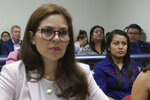 Evelyn Beatriz Hernandez, right, sits in court during her second trial, after her 30-year sentence for abortion was overturned in February, in Ciudad Delgado on the outskirts of San Salvador, El Salvador, Monday, July 15, 2019. The young woman who birthed a baby into a pit latrine in El Salvador faces a second trial for murder Monday in a case that has drawn international attention because of the country's highly restrictive abortion laws. (AP Photo/Salvador Melendez)