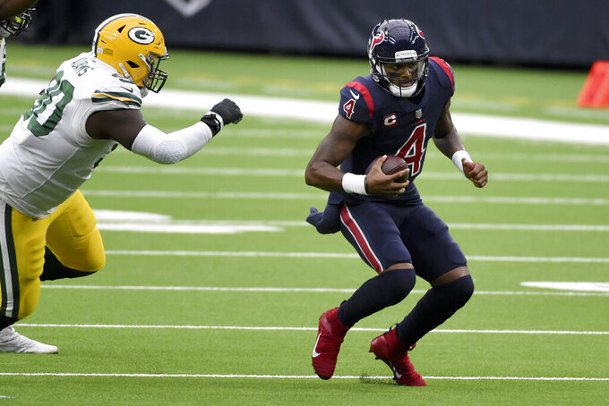 Houston Texans quarterback Deshaun Watson (4) scrambles away from Green Bay Packers defensive tackle Montravius Adams during the first half of an NFL football game Sunday, Oct. 25, 2020, in Houston. (AP Photo/Eric Christian Smith)