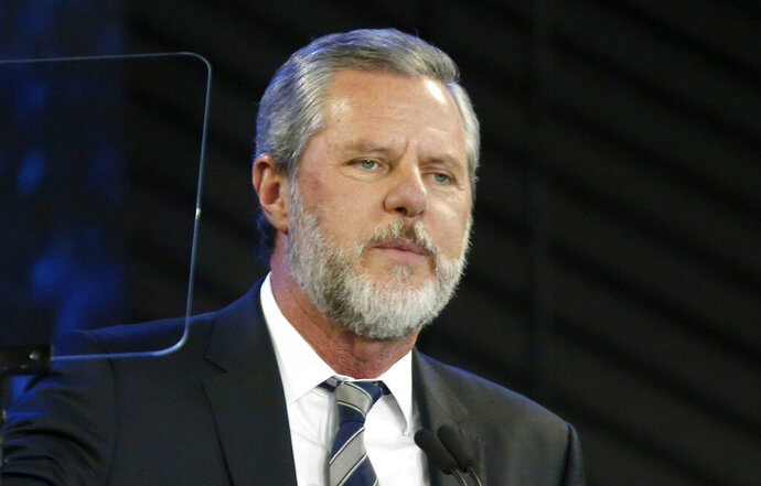 FILE - In this Nov. 28, 2018, file photo, Liberty University President Jerry Falwell Jr. speaks before a convocation at the university in Lynchburg, Va. Liberty's board said Monday, Aug. 10, 2020, that it had chosen Jerry Prevo as interim leader, days after Falwell began a leave of absence after one of his posts on social media created an uproar. (AP Photo/Steve Helber, File)