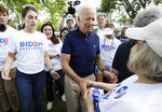 Former vice president and Democratic presidential candidate Joe Biden greets supporters before walking in the Independence Fourth of July parade, Thursday, July 4, 2019, in Independence, Iowa. (AP Photo/Charlie Neibergall)