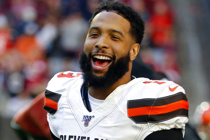 "FILE - In this Dec. 15, 2019, file photo, Cleveland Browns wide receiver Odell Beckham (13) laughs during an NFL football game against the Arizona Cardinals in Glendale, Ariz. Beckham, who skipped Cleveland's program last spring after being acquired from the Giants, has been a ""model guy"" during the team's virtual program. (AP Photo/Rick Scuteri, File)"