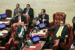 Minority party Senators, from left, Juan Dalmau, Eduardo Bhatia, Jose Luis Dalmau and Anibal Jose Torres listen to the position of the Senate President Thomas Rivera Schatz against the confirmation of Pedro Pierluisi, currently the secretary of state, as new governor in San Juan, Puerto Rico, Monday, Aug. 5, 2019. Puerto Rico's Supreme Court on Monday agreed to rule on a lawsuit that the island's Senate filed in a bid to oust the veteran politician, Pierluisi, recently sworn in as the island's governor. (AP Photo/Dennis M. Rivera Pichardo)