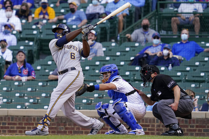 Milwaukee Brewers' Lorenzo Cain hits a three-run home run against the Chicago Cubs during the 10th inning of a baseball game in Chicago, Wednesday, April 7, 2021. (AP Photo/Nam Y. Huh)