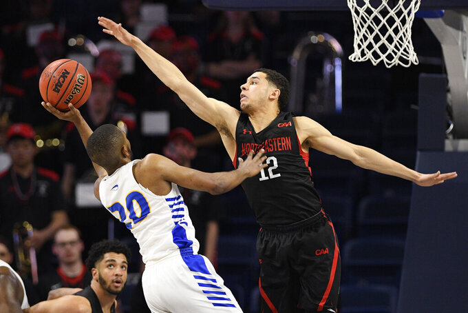 Hofstra guard Jalen Ray (20) goes to the basket against Northeastern guard Jordan Roland (12) during the first half of an NCAA college basketball game for the championship of the Colonial Athletic Association men's tournament Tuesday, March 10, 2020, in Washington. (AP Photo/Nick Wass)