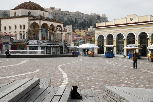 A stray cat yawning as a few pedestrians gather in Monastiraki square, usually the most crowded area in central Athens, during a lockdown order by the Greek government to prevent the spread of the new coronavirus, Wednesday, April 1, 2020. The Greek government has warned Greeks they will have to forego their Easter traditions this year as the country tackles the COVID-19 outbreak. Orthodox Easter, which this year falls on April 19, is by far the largest religious holiday in Greece. (AP Photo/Thanassis Stavrakis)