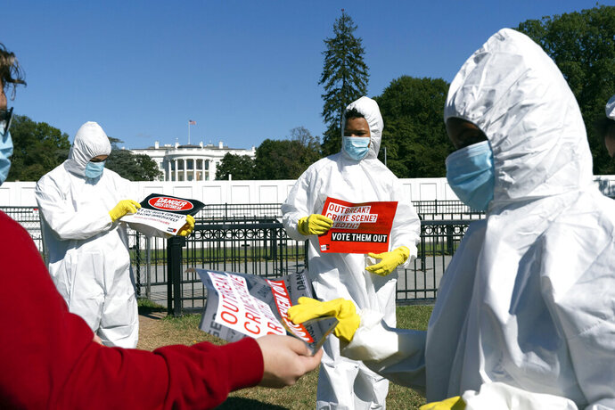 A group protests the ongoing outbreak of coronavirus in the White House, Thursday, Oct. 8, 2020, outside the White House in Washington. (AP Photo/Jacquelyn Martin)