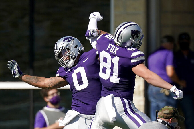 Kansas State tight end Briley Moore (0) celebrates with Kansas State tight end Konner Fox (81) after scoring a touchdown during the first half of an NCAA college football game against Texas Tech Saturday, Oct. 3, 2020, in Manhattan, Kan. (AP Photo/Charlie Riedel)