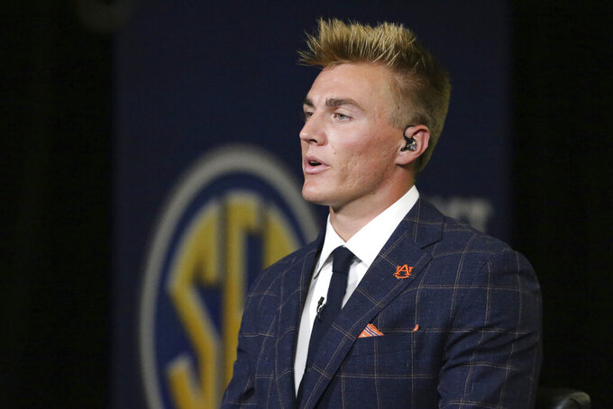 Auburn's Bo Nix speaks during a television interview at the NCAA college football Southeastern Conference Media Days, Thursday, July 22, 2021, in Hoover, Ala. (AP Photo/Butch Dill)