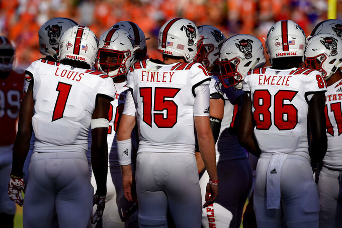 North Carolina State quarterback Ryan Finley (15) works in the huddle during the first half of an NCAA college football game against Clemson Saturday, Oct. 20, 2018, in Clemson, S.C. (AP Photo/Richard Shiro)