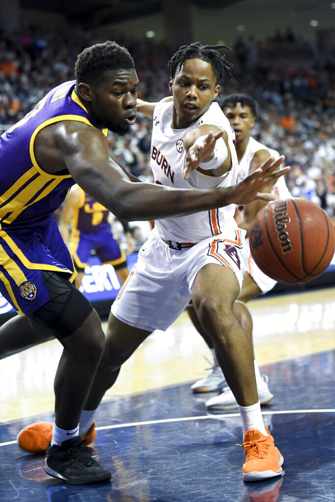 LSU guard Parker Edwards (3) and Auburn forward Isaac Okoro (23) battle for a rebound during the first half of an NCAA college basketball game Saturday, Feb. 8, 2020, in Auburn, Ala. (AP Photo/Julie Bennett)