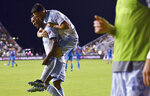 D.C. United defender Brendan Hines-Ike (4) jumps onto the back of teammate Ola Kamara after Kamara scored a goal against Inter Miami during the second half of an MLS soccer match Saturday, May 29, 2021, in Fort Lauderdale, Fla. (AP Photo/Jim Rassol)