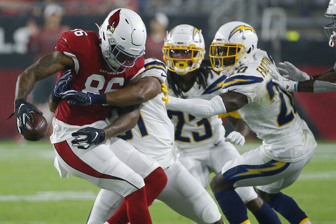 Arizona Cardinals tight end Ricky Seals-Jones (86) makes the catch as Los Angeles Chargers defensive back Adrian Phillips, defensive back Rayshawn Jenkins (23) and defensive back Brandon Facyson (28) defend during the first half of an NFL preseason football game, Thursday, Aug. 8, 2019, in Glendale, Ariz. (AP Photo/Rick Scuteri)