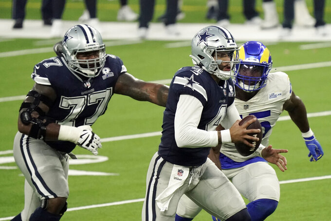 Dallas Cowboys quarterback Dak Prescott runs against the Los Angeles Rams during the first half of an NFL football game Sunday, Sept. 13, 2020, in Inglewood, Calif. (AP Photo/Jae C. Hong)