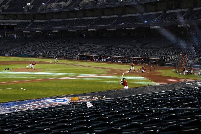The Arizona Diamondbacks play an intrasquad baseball game Tuesday, July 7, 2020, in Phoenix. (AP Photo/Matt York)