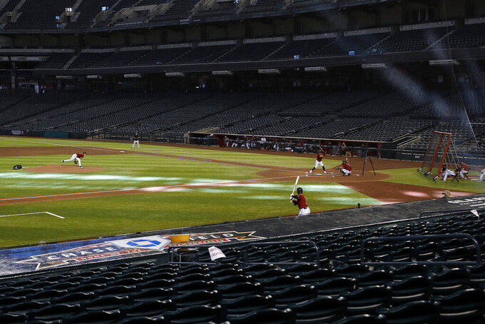 The Arizona Diamondbacks play an intrasquad baseball game Tuesday, July 7, 2020, in Phoenix. (AP Photo/Matt York)