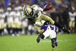 Baltimore Ravens safety Ar'Darius Washington, bottom, forces a fumble by New Orleans Saints running back Tony Jones Jr. during the second half of an NFL preseason football game, Saturday, Aug. 14, 2021, in Baltimore. The Ravens recovered the fumble. (AP Photo/Nick Wass)