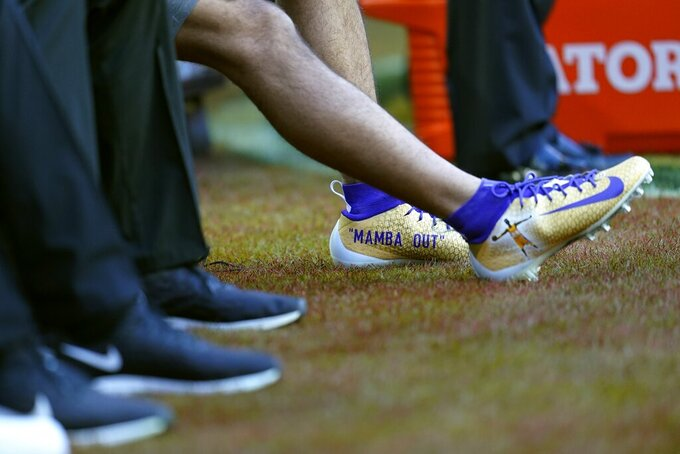 San Francisco 49ers wide receiver Dante Pettis wears cheats honoring Kobe Bryant before the NFL Super Bowl 54 football game against the Kansas City Chiefs Sunday, Feb. 2, 2020, in Miami. (AP Photo/David J. Phillip)