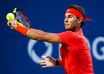 Rafael Nadal, of Spain, returns the ball against Marin Cilic, of Croatia, during quarterfinal men's Rogers Cup tennis action in Toronto, Friday, Aug. 10, 2018. (Nathan Denette/The Canadian Press via AP)