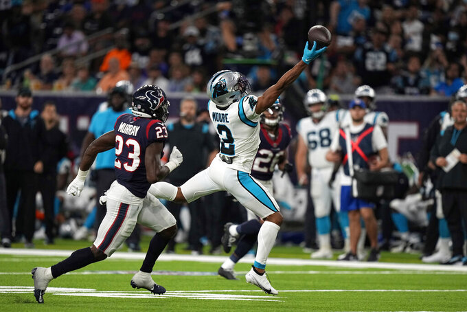Carolina Panthers wide receiver DJ Moore (2) reaches for an incomplete pass as Houston Texans safety Eric Murray (23) defends during the second half of an NFL football game Thursday, Sept. 23, 2021, in Houston. (AP Photo/Eric Christian Smith)