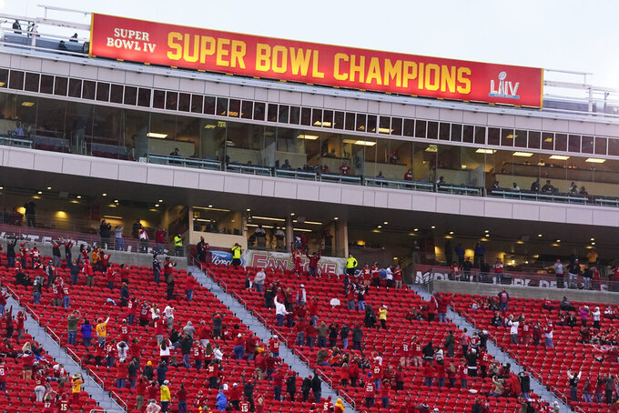 The Kansas City Chiefs' Super Bowl banner is unveiled before an NFL football game between the Chiefs and the Houston Texans Thursday, Sept. 10, 2020, in Kansas City, Mo. (AP Photo/Jeff Roberson)