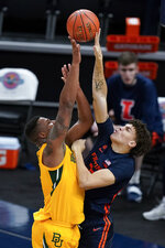 Baylor's Mark Vital, left, has his shot blocked by Illinois' Coleman Hawkins during the first half of an NCAA college basketball game, Wednesday, Dec. 2, 2020, in Indianapolis. (AP Photo/Darron Cummings)