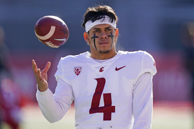 Washington State quarterback Jayden de Laura (4) warms up before an NCAA college football game against Utah, Saturday, Dec. 19, 2020, in Salt Lake City. (AP Photo/Rick Bowmer)