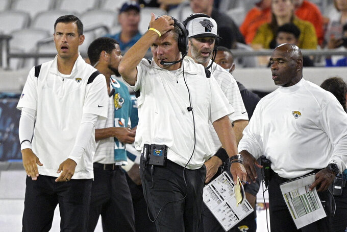 Jacksonville Jaguars head coach Urban Meyer paces the sideline during the second half of an NFL preseason football game against the Cleveland Browns, Saturday, Aug. 14, 2021, in Jacksonville, Fla. (AP Photo/Phelan M. Ebenhack)