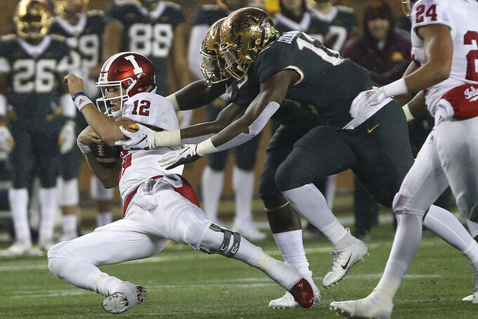 Indiana quarterback Peyton Ramsey slides to stop the play during an NCAA college football game against Minnesota, Friday, Oct. 26, 2018, in Minneapolis. Minnesota won 38-31. (AP Photo/Stacy Bengs)