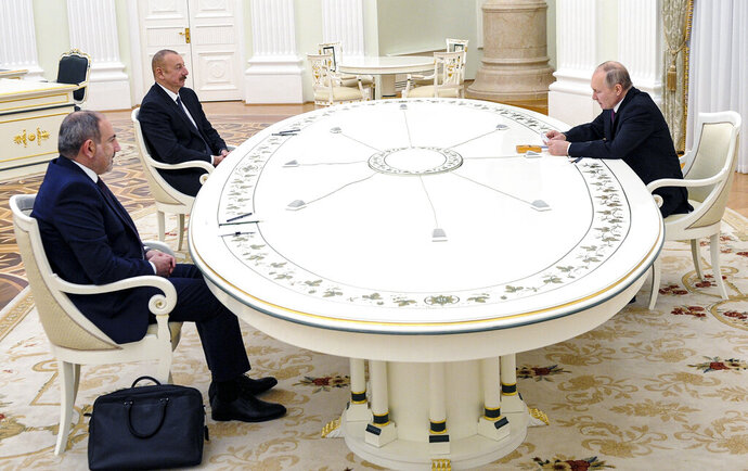 Russian President Vladimir Putin, right, attends a talks with Azerbaijan's President Ilham Aliyev, second left, and Armenian Prime Minister Nikol Pashinyan, left, in the Kremlin in Moscow, Russia, Monday, Jan. 11, 2021. Putin hosted the leaders of Armenia and Azerbaijan for talks after six weeks of fierce fighting over Nagorno-Karabakh that ended with a Russia-brokered peace deal in November. (Mikhail Klimentyev, Sputnik, Kremlin Pool Photo via AP)