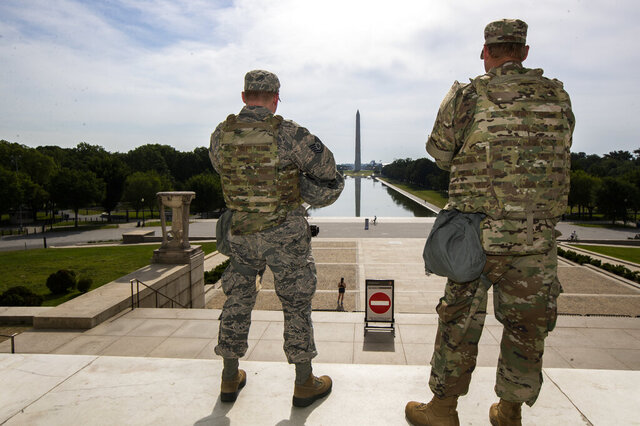 FILE - In this June 3, 2020 file photo members of the District of Columbia Army National Guard stand guard at the Lincoln Memorial in Washington securing the area as protests continue following the death of George Floyd, a who died after being restrained by Minneapolis police officers. An Ohio National Guardsman was removed from policing protests in Washington D.C. after the FBI found he expressed white supremacist ideology online, Gov. Mike DeWine announced in a briefing Friday, June 5, 2020. (AP Photo/Manuel Balce Ceneta)