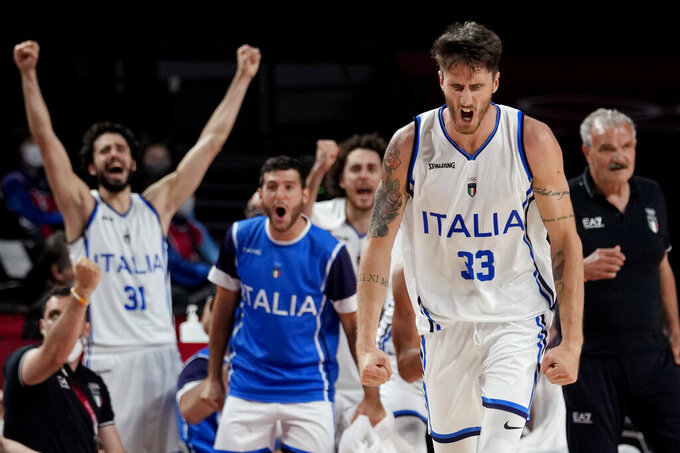 Italy's Achille Polonara (33) reacts after a score against France during a men's basketball quarterfinal round game at the 2020 Summer Olympics, Tuesday, Aug. 3, 2021, in Saitama, Japan. (AP Photo/Eric Gay)