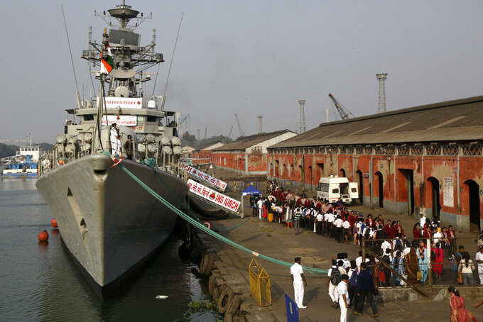 File - In this Dec. 5, 2019, file photo, Indian school children walk past the visiting Indian Navy warship INS Kirch for a guided tour in Kolkata, India. India is sending four navy ships for exercises and port visits with the Philippines, Vietnam, Singapore, Indonesia and Australia to strengthen cooperation in the Indo-Pacific region, its navy said Wednesday, as China's maritime power grows in the area. (AP Photo/Bikas Das, File)