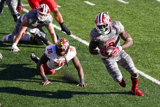 Indiana running back Stevie Scott III (8) runs past Maryland's Durell Nchami (30) for a touchdown during the second half of an NCAA college football game, Saturday, Nov. 28, 2020, in Bloomington, Ind. Indiana won 27-11. (AP Photo/Darron Cummings)