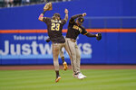 San Diego Padres' Tommy Pham, right, and Fernando Tatis Jr. celebrate after a baseball game against the New York Mets at Citi Field, Sunday, June 13, 2021, in New York. The Padres defeated the Mets 7-3. (AP Photo/Seth Wenig)