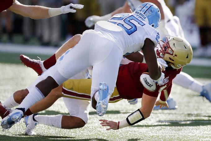North Carolina linebacker Kaimon Rucker (25) sacks Boston College quarterback Phil Jurkovec during the first half of an NCAA college football game, Saturday, Oct. 3, 2020, in Boston. (AP Photo/Michael Dwyer)