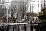 National Guard troops continue to be deployed around the Capitol one day after the inauguration of President Joe Biden, Thursday, Jan. 21, 2021, in Washington. (AP Photo/Rebecca Blackwell)