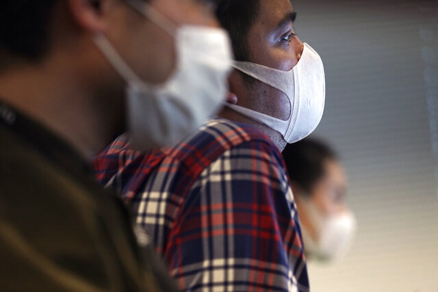 Staff of an artificial intelligence company GumGum Japan work at their office Tuesday, Feb. 25, 2020, in Tokyo. Japanese Prime Minister Shinzo Abe said Tuesday that companies should allow employees to work from home and hospitals must expand their treatment capacity in order for Japan to control its virus outbreak. GumGum Japan, an artificial intelligence company that already allowed flexible hours, now is telling all of its employees to work from home. It also banned unessential business trips and hopes to communicate with business partners via phone and video conferences.  (AP Photo/Eugene Hoshiko)